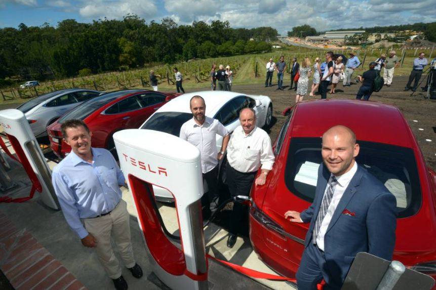 Electric refuel: Tesla Motors yesterday launched their supercharger station at Cassegrain. Federal Member for Cowper Luke Hartsuyker, Supercharger program manager Australia Evan Beaver, Cassegrain Winery's John Cassegrain and senior marketing and communications manager with Tesla, Heath Walker. Pic: Peter Gleeson
